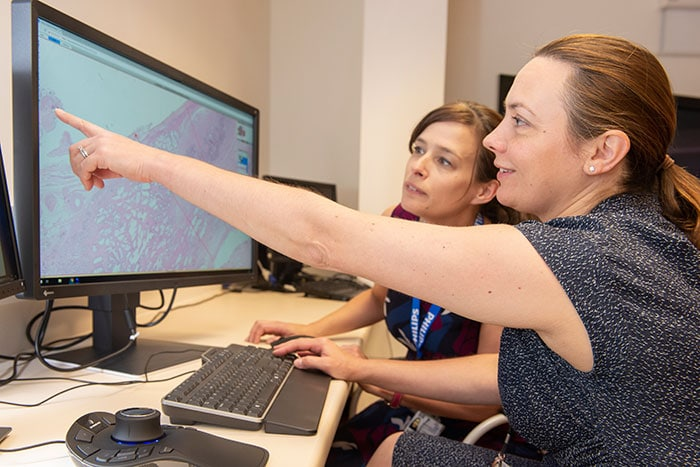 Download image (.jpg) Dr Lisa Browning and Professor Clare Verrill, Honorary Consultant in Cellular Pathology at Oxford University Hospitals working with Philips IntelliSite Pathology Solution�s Image Management System